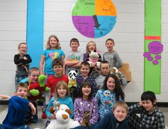 """Grade 3 students from Carman Elementary School show off the school's """"Wall of Support."""" The wall will be used to track fundraising for their new playground and to recognize donors. (SUBMITTED BY LORI WIEBE/FOR THE CARMAN VALLEY LEADER)"""