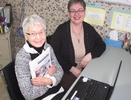 Shirley Fraser, left, with a Home and Not Alone manual, with project manager Danielle Bray, at the Tri-County Literacy Council office. TODD HAMBLETON/CORNWALL STANDARD-FREEHOLDER/QMI AGENCY