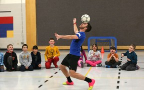 Ottawa Fury FC forward Carl Haworth shows off some skill for students at St. Anne Elementary School in Kanata on Tuesday. Haworth, along with teammates Mason Trafford, Nicki Paterson and Tommy Heinemann are touring Ottawa schools with their Pro Futsal Training program, which they started as an off-season side project to teach the indoor soccer game over the winter. (Chris Hofley/Ottawa Sun)