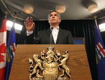 Premier Jim Prentice announces that the Cabinet will take a 5% pay cut with the MLAs to follow suit during a news conference at the Alberta Legislature in Edmonton, Alberta on Thursday Jan.29, 2015. Perry Mah/Edmonton Sun/