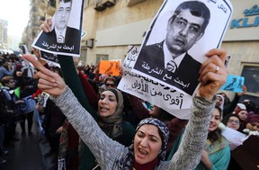 """Protesters chant anti-government slogans while holding """"Wanted"""" posters of Egyptian Interior Minister Mohamed Ibrahim during a protest by women at the same location in central Cairo where activist Shaimaa Sabbagh was killed during a protest on Saturday, January 29, 2015, one day before the anniversary of the popular uprising that ousted autocrat Hosni Mubarak in 2011. A group of women protested in Cairo on Thursday against the death of Sabbagh and around 25 other activists allegedly killed by security forces at recent rallies marking the anniversary of Egypt's 2011 uprising. Sabbagh, 32, died on Saturday as riot police were trying to break up a small, peaceful demonstration. Friends said she was shot and images of her bleeding body rippled out across social media, sparking outrage and condemnation.  REUTERS/Mohamed Abd El Ghany"""