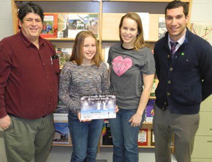 St. Thomas Aquinas Grade 7 student Riah Motlong, 12, is joined by her aunt Beth Chevalier during the presentation of the Ontario Junior Citizen of the Year Award nomination certificate by program co-sponsors Kenora Daily Miner and News managing editor Lloyd Mack, on behalf of the Ontario Community Newspaper Association, and Kenora branch TD Canada Trust representative Fabio Madonna. The presentation was made Thursday, Jan. 29. Reg Clayton/Daily Miner and News