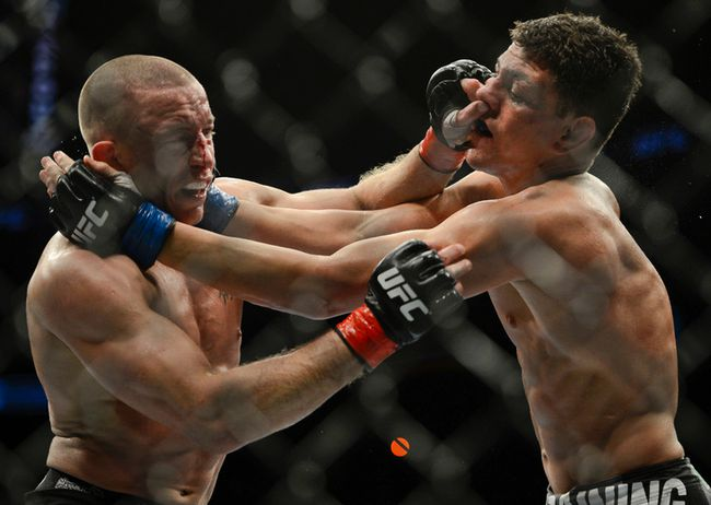 Nick Diaz battles George St. Pierre during UFC 158 at the Bell Centre on March 17, 2013. (MARTIN CHEVALIER/LE JOURNAL DE MONTRÉAL /QMI AGENCY)
