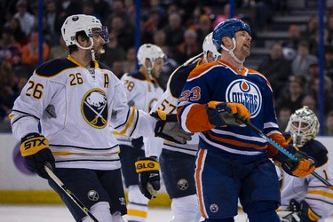 Edmonton centre Matt Hendricks (23) reacts as Buffalo goaltender Jhonas Enroth (1) makes a save during the first period of a NHL hockey game between the Edmonton Oilers and the Buffalo Sabres at Rexall Place in Edmonton, Alta., on Thursday, Jan. 29, 2015. Ian Kucerak/Edmonton Sun/ QMI Agency