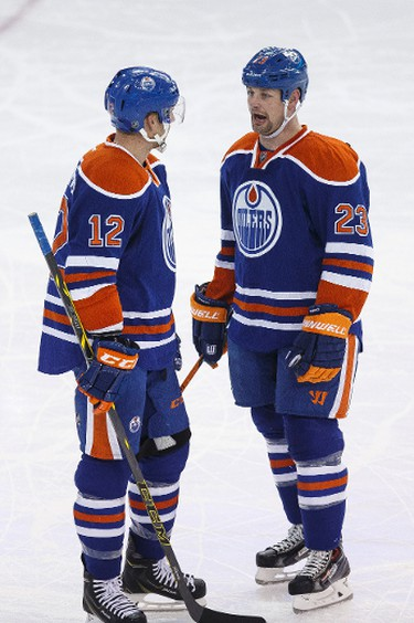 Edmonton centre Matt Hendricks (23) and forward Rob Klinkhammer (12) chat during the second period of a NHL hockey game between the Edmonton Oilers and the Buffalo Sabres at Rexall Place in Edmonton, Alta., on Thursday, Jan. 29, 2015. Ian Kucerak/Edmonton Sun/ QMI Agency