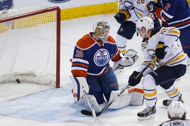 Buffalo defenceman Rasmus Ristolainen (55) scores on Edmonton goaltender Ben Scrivens (30) during the third period of a NHL hockey game between the Edmonton Oilers and the Buffalo Sabres at Rexall Place in Edmonton, Alta., on Thursday, Jan. 29, 2015. Ian Kucerak/Edmonton Sun/ QMI Agency
