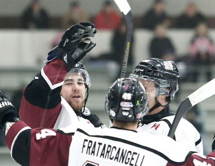 Chatham Maroons captain Steven Szekesy, left, is congratulated by Mark Fratarcangeli and Levi Tetrault after scoring in the first period against the Lambton Shores Predators on Thursday at Memorial Arena. (MARK MALONE/The Daily News)