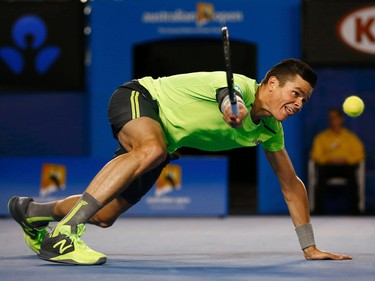 Milos Raonic of Canada stretches to hit a return against Novak Djokovic of Serbia during their men's singles quarter-final match at the Australian Open 2015 tennis tournament in Melbourne, January 28, 2015.  REUTERS/Thomas Peter