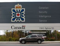 A vehicle passes a sign outside the Canadian Security Intelligence Service (CSIS) headquarters in Ottawa November 5, 2014. REUTERS/Chris Wattie