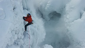 Canadians Will Gadd, 47, and Sarah Hueniken, 34, scaled the 15-storey icy, jagged U.S. side of Horseshoe Falls on Tuesday for a Red Bull-sponsored film project. (Red Bull/YouTube screengrab)