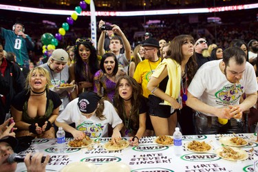 "Defending champion Molly Schuyler (2nd L) and Patrick ""Deep Dish"" Bertoletti (R) compete in the 23rd annual Wing Bowl at the Wells Fargo Center in Philadelphia, Pennsylvania January 30,  2015.   REUTERS/Mark Makela"