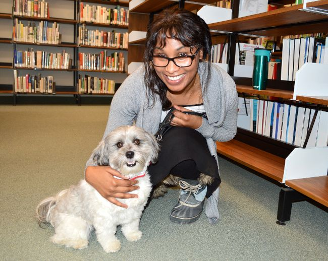 <p>Marc Benoit/Special to the Cornwall Standard-Freeholder/QMI Agency</p><p>First-year student Grace Muhuni poses with her new friend. Therapy dogs were on the scene at St. Lawrence College in Cornwall on Jan. 28, 2015, to help relieve stress amongst students.
