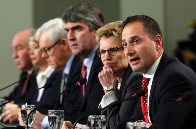 Prince Edward Island Premier Robert Ghiz (R) speaks during a news conference following a meeting of provincial and territorial premiers in Ottawa January 30, 2015. REUTERS/Chris Wattie