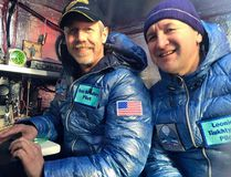 Pilots Troy Bradley (left) and Leonid Tiukhtayev sit in the capsule of the Two Eagles balloon before setting off on their attempt to cross the Pacific in Saga, Saga Prefecture, Jan. 25, 2015. (TAMARA BRADLEY/Two Eagles Balloon Team/Handout via Reuters)