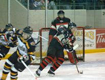 Brantford Blast captain Mike Burgoyne heads up ice on Friday against the Whitby Dunlops in an Allan Cup Hockey game at the civic centre. (Expositor photo)