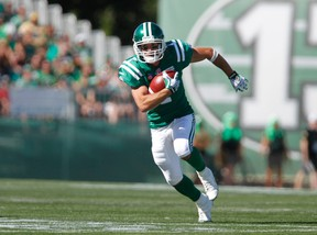 Roughriders slotback Weston Dressler runs up the ball while playing against the Blue Bombers during first half CFL action in Regina on Aug. 31, 2014. (David Stobbe/Reuters/Files)