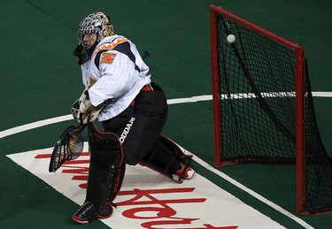 The Edmonton Rush Chris Corbeil's (not pictured) shot gets past the New England Black Wolves' Evan Kirk (35) during first half NLL action at Rexall Place, in Edmonton Alta., on Friday Jan. 30, 2015. David Bloom/Edmonton Sun/QMI Agency