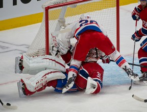 Washington Capitals forward Troy Brouwer runs over Montreal Canadiens goalie Carey Price during NHL play Saturday at the Bell Centre. (PIERRE-PAUL POULIN/QMI Agency)