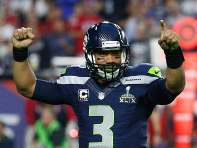 Seattle Seahawks quarterback Russell Wilson celebrates his touchdown pass to  wide receiver Chris Matthews (not pictured)  in the final seconds of the first half against the New England Patriots during the NFL Super Bowl XLIX football game in Glendale, Arizona, February 1, 2015.  REUTERS/Lucy Nicholson