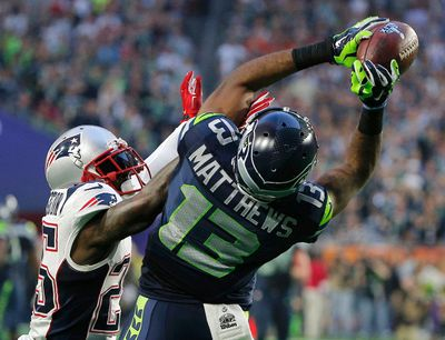 Seattle Seahawks wide receiver Chris Matthews (13) catches a pass against New England Patriots cornerback Kyle Arrington (25) in the second quarter during the NFL Super Bowl XLIX football game in Glendale, Arizona February 1, 2015. REUTERS/Brian Snyder