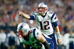 Tom Brady of the New England Patriots signals in the second half against the Seattle Seahawks during Super Bowl XLIX at University of Phoenix Stadium on February 1, 2015. (Kevin C. Cox/Getty Images/AFP)