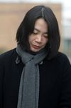 Cho Hyun-ah, also known as Heather Cho, daughter of chairman of Korean Air Lines, Cho Yang-ho, appears in front of the media outside the offices of the Aviation and Railway Accident Investigation Board of the Ministry of Land, Infrastructure, Transport, in Seoul December 12, 2014. (REUTERS/Song Eun-seok/News1)