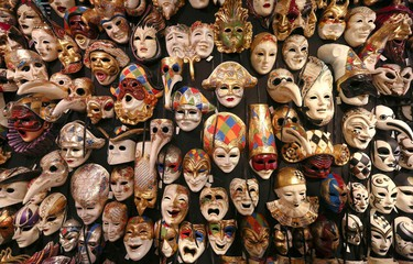 """Carnival masks hang on a wall in the """"Ca' del Sol"""" artisan shop near St. Mark's square during the first day of carnival in Venice February 1, 2015. REUTERS/Stefano Rellandini"""