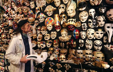 """Iranian mask artisan Hamid works in his shop """"Ca' del Sol"""" near St. Mark's square during the first day of carnival in Venice February 1, 2015. REUTERS/Stefano Rellandini"""