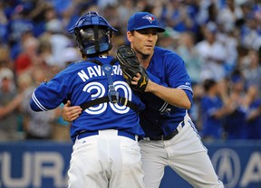 Toronto Blue Jays catcher Dioner Navarro (30) and relief pitcher Casey Janssen (44) celebrate the win against Baltimore Orioles at Rogers Centre. Blue Jays won 4-2. (Peter Llewellyn-USA TODAY Sports)