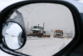 Plows make there way across a stretch of Sheppard Ave. on Monday. (DAVE THOMAS, Toronto Sun) February 2, 2015. Dave Thomas/Toronto Sun/QMI Agency
