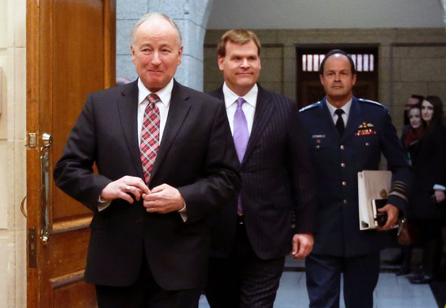 Canada's Defence Minister Rob Nicholson (left to right), Foreign Minister John Baird and Chief of Defence Staff General Tom Lawson arrive to testify before the Commons foreign affairs committee on Parliament Hill in Ottawa, Jan. 29, 2015. (CHRIS WATTIE/Reuters)