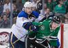 St. Louis Blues defenceman Kevin Shattenkirk (22) checks Dallas Stars forward Antoine Roussel during the NHL play at the American Airlines Center. (Jerome Miron/USA TODAY Sports)