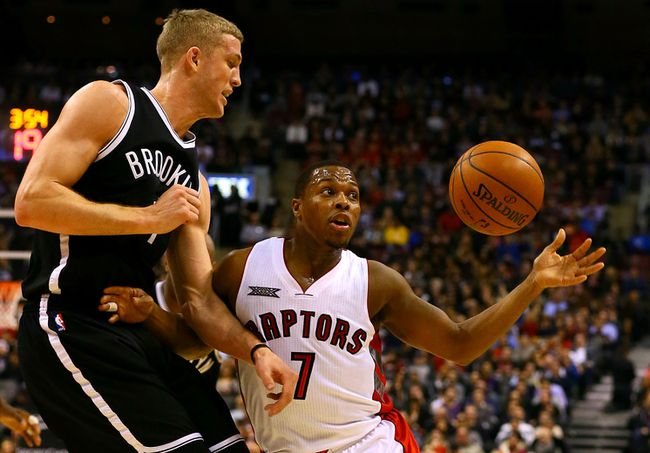 Raptors' Kyle Lowry tries to grab the ball while being defended by Mason Plumlee of the Brooklyn Nets on Feb. 4 (Dave Abel, Toronto Sun)