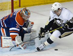 Penguins forward David Perron is stopped by Viktor Fasth during the second period of Wednesday's game. Perron ran over Fasth at one point in the game, sparking a heated outburst from the goalie. (David Bloom, Edmonton Sun)