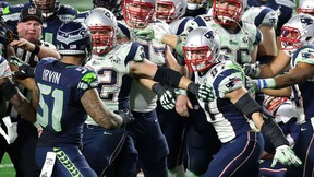 Bruce Irvin of the Seattle Seahawks and Rob Gronkowski of the New England Patriots exchange words late in the fourth quarter during Super Bowl XLIX. (Andy Lyons/Getty Images/AFP)