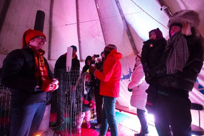 Visitors drink tea and listen to singers perform in a tipi during the Flying Canoe in Mill Creek Ravine in Edmonton, Alta., on Friday, Feb. 6, 2014. The Flying Canoe Volant is an annual celebration of French Canadian and First Nations culture in the ravine and at La Cite Francophone, which is being held on Feb. 6 -7 this year. Ian Kucerak/Edmonton Sun/ QMI Agency
