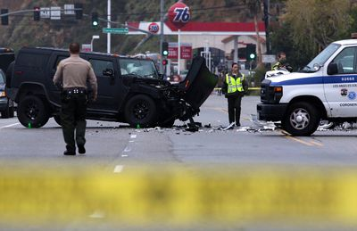 A damaged vehicle (L) is pictured at the scene of a four-car crash involving Olympic gold medalist and reality TV star Bruce Jenner in Malibu, California, February 7, 2015.  REUTERS/Jonathan Alcorn