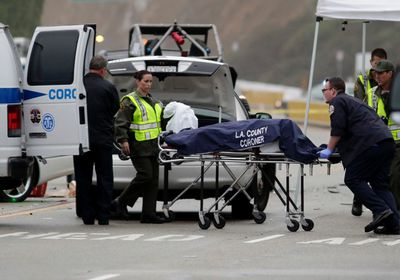 A Los Angeles County coroner worker loads a victim into a van at the scene of a four-car crash involving Olympic gold medalist and reality TV star Bruce Jenner in Malibu, California, February 7, 2015. REUTERS/Jonathan Alcorn