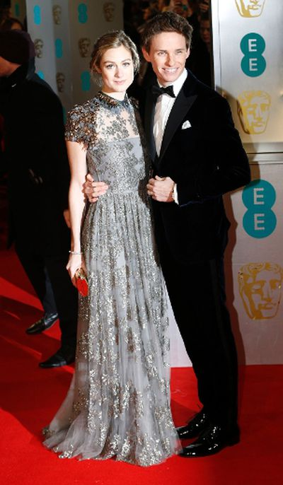 Actor Eddie Redmayne and his wife Hannah Bagshawe arrive at the British Academy of Film and Arts (BAFTA) awards ceremony at the Royal Opera House in London February 8, 2015. REUTERS/Suzanne Plunkett