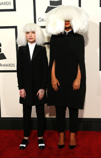 Singer Sia (R) and dancer Maddie Ziegler arrive at the 57th annual Grammy Awards in Los Angeles, California February 8, 2015.   REUTERS/Mario Anzuoni
