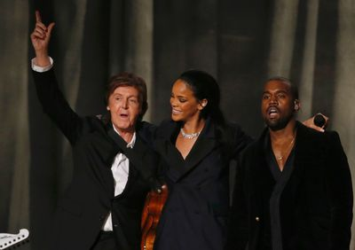"""Paul McCartney, Rihanna and Kanye West (R) celebrate after performing """"FourFiveSeconds"""" at the 57th annual Grammy Awards in Los Angeles, California February 8, 2015.   REUTERS/Lucy Nicholson"""