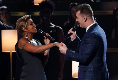 """Sam Smith performs """"Stay With Me"""" with Mary J. Blige at the 57th annual Grammy Awards in Los Angeles, California February 8, 2015.   REUTERS/Lucy Nicholson"""