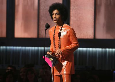Prince presents the award for album of the year at the 57th annual Grammy Awards in Los Angeles, California February 8, 2015.   REUTERS/Lucy Nicholson