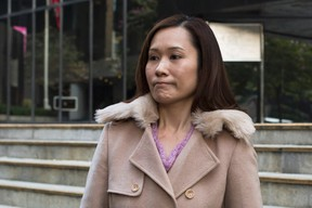 Law Wan-tung, former employer of Indonesian domestic helper Erwiana Sulistyaningsih, leaves the district court in Hong Kong, in this Jan. 8, 2015 file photo. (REUTERS/Tyrone Siu/Files)