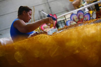 A worker prepares part of a carnival float at the Mangueira Samba School, in preparation for the annual carnival parade in Rio de Janeiro February 2, 2015. The Rio de Janeiro Carnival will be held from February 14 to 17. REUTERS/Ricardo Moraes