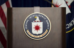 The lectern stands empty as reporters await the arrival of Director of Central Intelligence Agency John Brennan for a press conference at CIA headquarters in McLean, Virginia, December 11, 2014.  AFP PHOTO/JIM WATSON