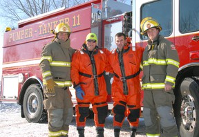 Central Elgin firefighters from Port Stanley station checked out the ice conditions Tuesday at Little Beach in advance of the Port Stanley Polar Bear Dip, March 28. The first-time event is in aid of Childcan, the Childhood Cancer Research Association. Ian McCallum/Times-Journal