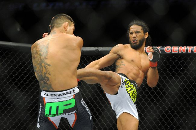 Benson Henderson (red gloves) fights Rafael Dos Anjos (blue gloves) in the Main Event, Lightweight Bout at BOK Center. (Mark D. Smith-USA TODAY Sports)