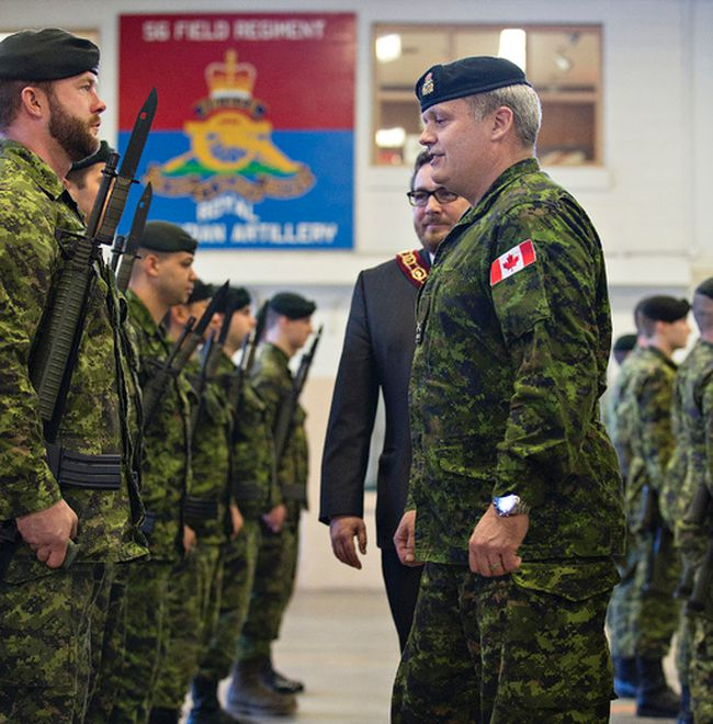 Brigadier-General Lowell Thomas and Brantford Mayor Chris Friel inspect members of the 56th Field Regiment RCA on Thursday, February 12, 2015 at the armouries in Brantford, Ontario.  Thomas, who commands the 4th Canadian Divistion visited the city to recognize Brantford's commemoration of the Afghanistan National Day of Honour in May of 2014.