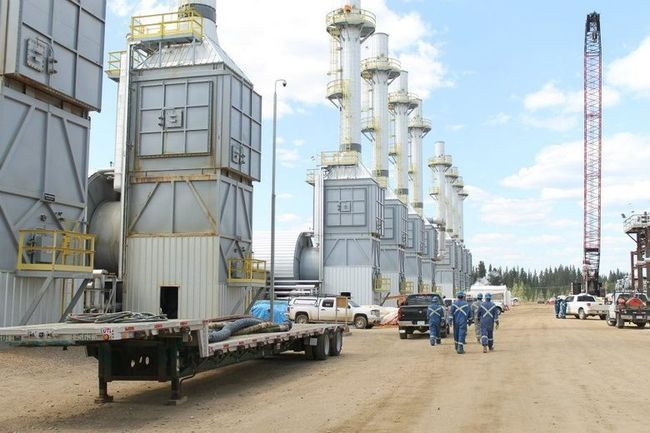 Workers at Cenovus Energy's Christina Lake walk past several gravity separators after their shift. VINCENT MCDERMOTT/TODAY FILE PHOTO